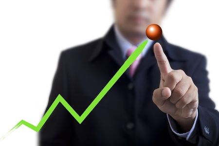 Businessman drawing a graph on the board photo