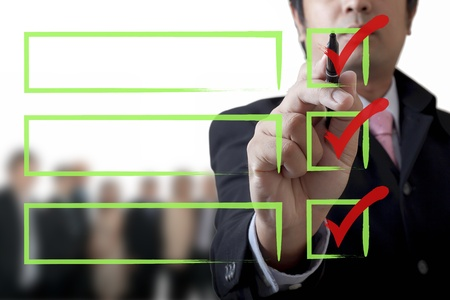 expertise: Businessman drawing a graph on the board Stock Photo