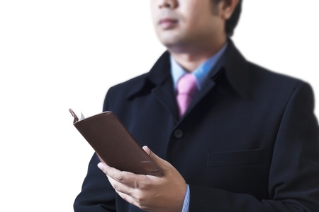 Businessman holding a book in hand Stock Photo