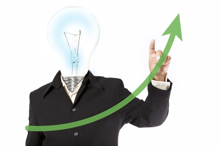 Businessman drawing a graph on the board Stock Photo