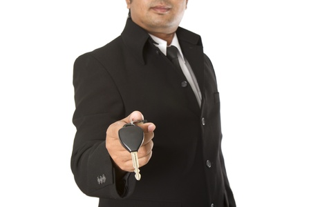 Businessman holding the key on a white background photo