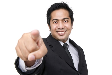 business man pointing at you against white background photo