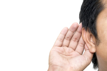 blab: Close up on hand and ear  Stock Photo