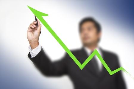 businessman hand touch virtual graph Stock Photo
