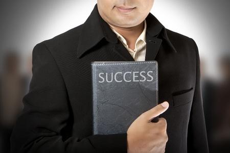 business executive enjoying success with team mates