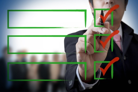 Businessman drawing a graph on the board Stock Photo - 13589653