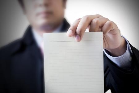 Businessman holding white billboard  photo