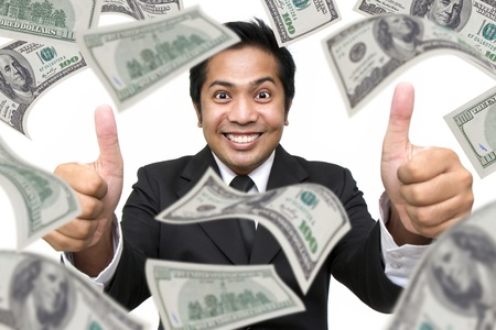 Businessman with money around isolated against a white background photo