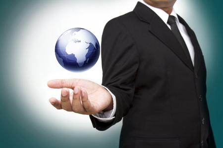 hand holding the business world Stock Photo