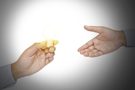 Light bulb in a hand