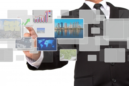 businessman pushing on a touch screen interface Stock Photo