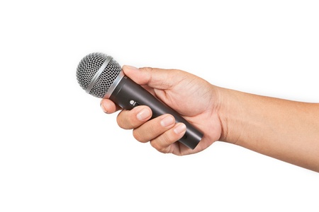 Hand with microphone isolated on white background Stock Photo - 14964544