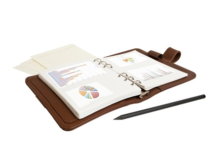 financial charts and graphs on notebook