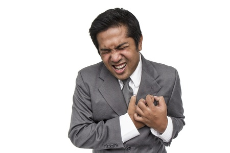 Young businessman having heart attack Stock Photo