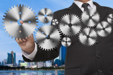 Businessman shows gear to success Stock Photo