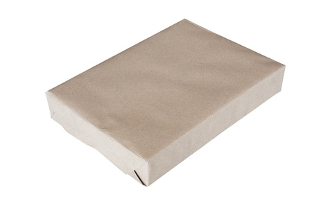Parcel wrapped in brown paper and tied with rough twine and blank label, isolated on white background
