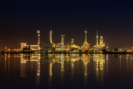Oil refinery industrial plant at night Editorial