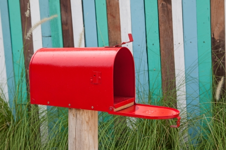 Red mail box on wooden wall Stock Photo - 18758474