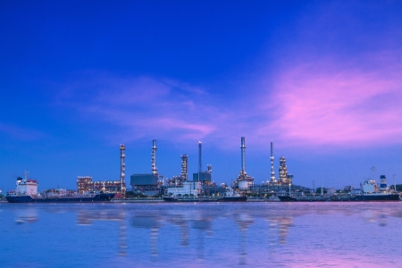 Oil refinery industrial plant at sun set