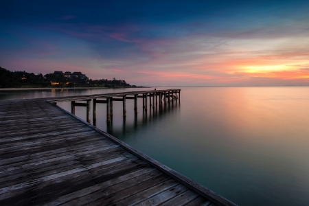 sunrise with dramatic sky and a jetty Stock Photo