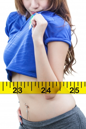 Woman measuring perfect shape of beautiful hips. Healthy lifestyles concept Stock Photo