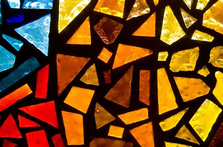 A close up of a colorfull stained glass window.