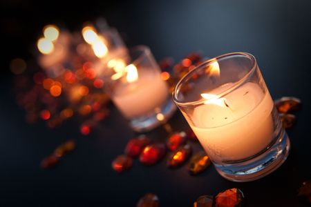 Candles with orange gems surrounding them. Reklamní fotografie