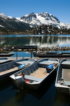 Several rental motor boats on a high Sierra lake.