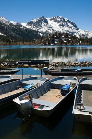 high sierra: Several rental motor boats on a high Sierra lake.