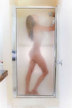 A silhouette of a women in a steamy shower. photo
