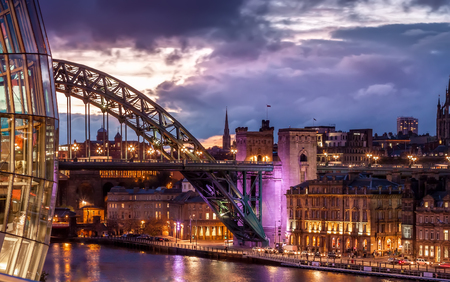 Tyne Bridge and night cityscape under colourful sunset, Newcastle upon Tyne, England, UK