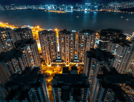 High Rise Urban Buildings with Colourful Lights at Night, Hong Kong