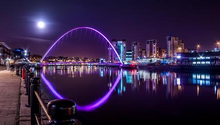 Millennium Bridge under Night Sky and Full Moon, Newcastle upon Tyne, UK Stock Photo
