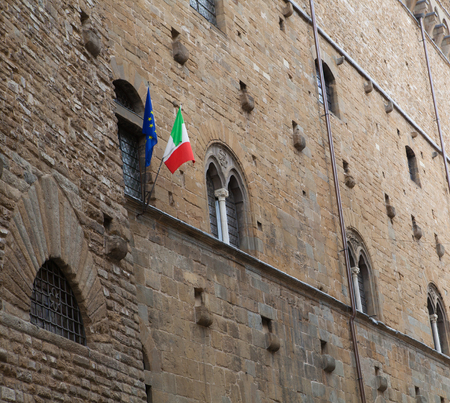 old building facade: Old building facade with the italian flag