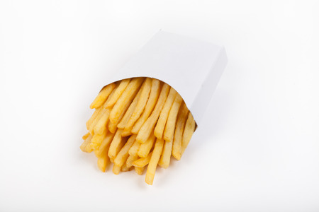 prepared: Prepared yellow french fries on white background