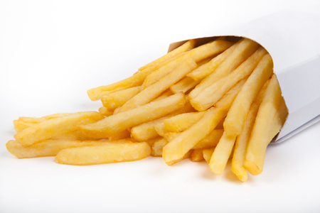Prepared yellow french fries on white background