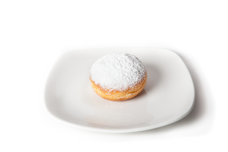 cake factory: Fresh baked donut with sugar on a white plate