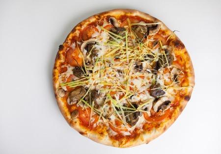 cep: Freshly baked whole pizza with cep mushrooms