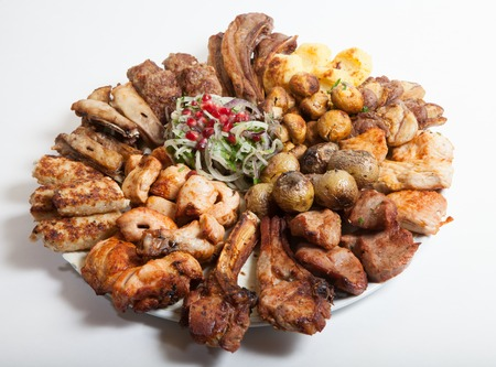 sorts: All different sorts of grilled meat on a big tray