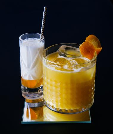 alcohol screwdriver: Cocktail with orange juice and vodka on black background
