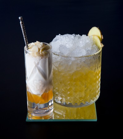 alcohol screwdriver: Fancy alcohol cocktail with ginger on black background