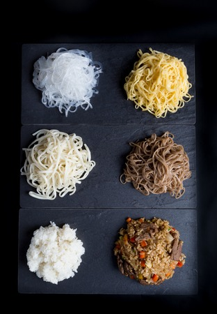 sorts: Different sorts of wok ingredients on a black Stock Photo