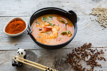 sour grass: Traditional thai spicy tom yum soup in a bowl