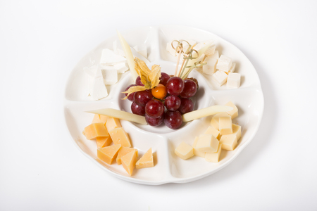 sorts: Different sorts of cheese served with grapes Stock Photo