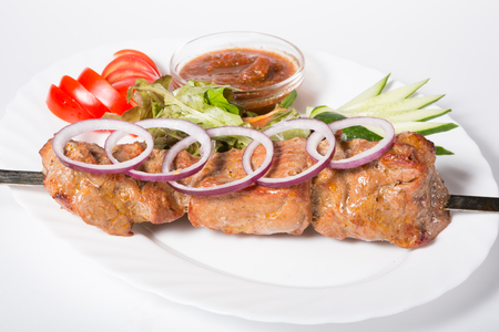 meat sauce: Grilled kebab meat on a skewer with vegetables Stock Photo