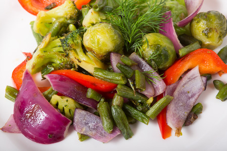 broccolli: Mixed green vegetables salad served on a white plate