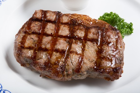 meaty: Grilled beef steak served with tomato sauce