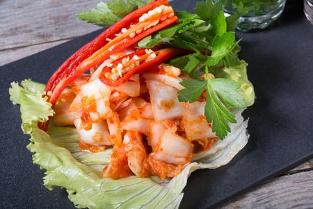 Korean marinated cabbage kimchi dish served with chili pepper