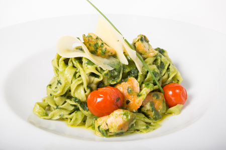 Italian spinach pasta served with cheese and chicken