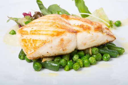 cod: Fried white fish fillet with peas garnish